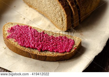 A Piece Of Bread And Fresh Horseradish Sauce With Beets. A Slice Of Rye Bread With Hot Sauce. An Ang