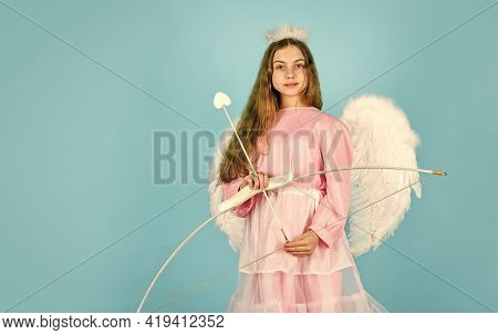 Small Angel. Girl Cupid Hold Bow And Arrow. Cupids Arrow Hit Right In Heart. Love And Romance. Happy