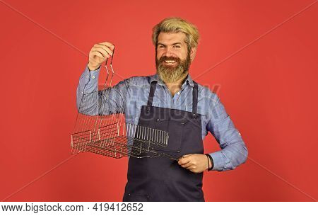 Bbq Food. Culinary Concept. Tools Roasting Meat. Man In Apron Hold Barbecue Grill. Cooking Utensils.
