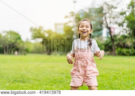 Movement Of Smiling Little Girl Jumping In The Park, Energetic Girl Jumping With Blurry Movement,  H