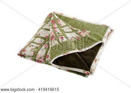 Patchwork Green-white Quilt On A White Background. Patchwork Blanket. Handmade. Patchwork Quilt On A