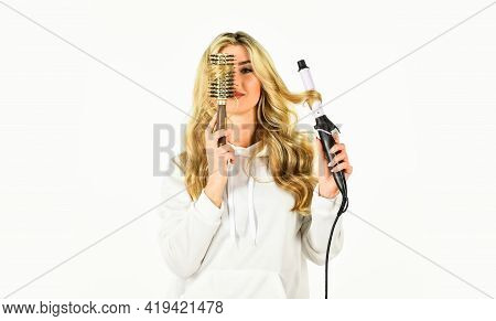 Create Hairstyle. Woman With Long Curly Hair Use Curling Iron. Girl Adorable Blonde. Hairdresser Tip
