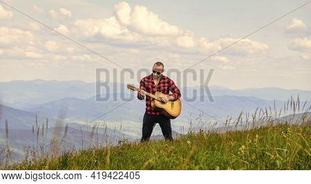 Hiker Enjoy Nature. Musician Hiker Find Inspiration In Mountains. Keep Calm And Play Guitar. Man Hik