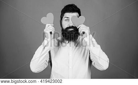 Man Bearded Hipster With Heart Valentine Card. Celebrate Love. Guy Attractive Beard And Mustache In