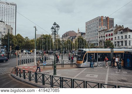 Brussels, Belgium - August 16, 2019: High Angle View Of People Boarding A Tram At A Stop In Brussels