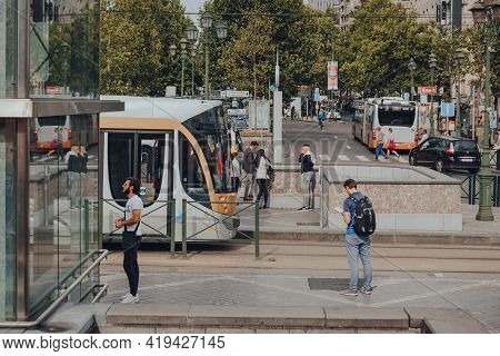 Brussels, Belgium - August 16, 2019: High Angle View Of People And Tram At A Stop In Brussels, The C