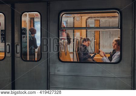 Brussels, Belgium - August 16, 2019: View Through Window Of People Inside Brussels Metro Carriage. C