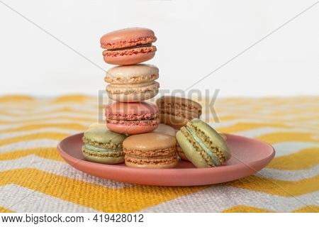 Pastel color macarons on plate gourmet dessert baking french pastry.