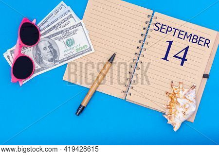 14th Day Of September. Travel Concept Flat Lay - Notepad With The Date Of 14 September Pen, Glasses,