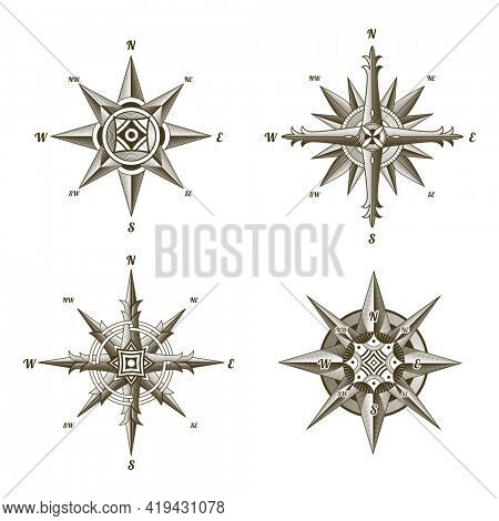 Collection of nautical antique compass signs. Old  design elements for marine theme and heraldry on white background. Vintage  wind rose labels emblem
