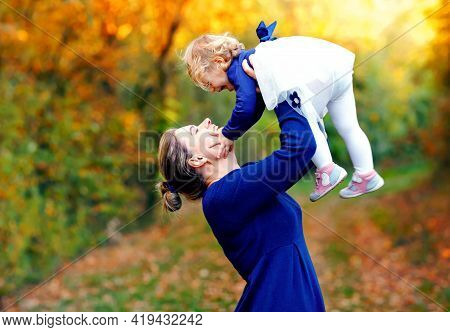 Happy Young Mother Having Fun Cute Toddler Daughter, Family Portrait Together. Woman With Beautiful