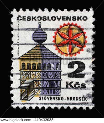 ZAGREB, CROATIA - SEPTEMBER 18, 2014: Stamp printed in Czechoslovakia shows Wooden bell tower in Hronsek, circa 1971