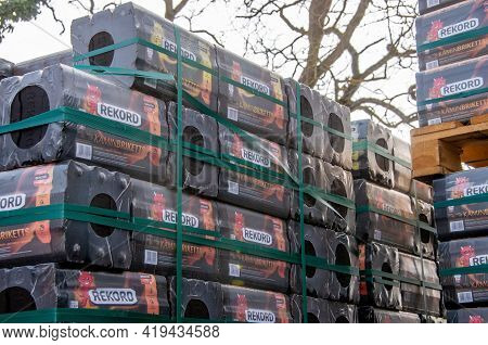 Bamberg, Germany - 10.4.2021. Brand Rekord-brand Edcoal Briquettes Are Stored On A Pallet In Front O