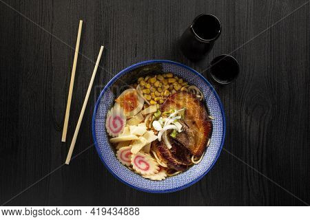 Japanese Miso Ramen Soup On Dark Background Viewed From Above. Japanese Noodles.