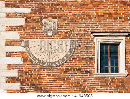 Sundial And A Window In The Tower