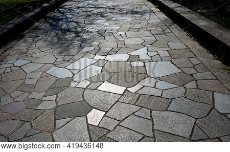 Natural Paving Of Gneiss And Granite Irregular Stones Folded Into A Beautiful Pattern Where Larger S