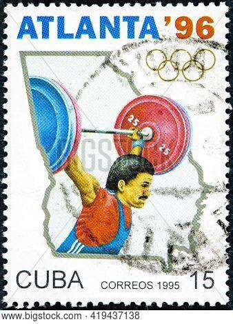 Cuba - Circa 1995: A Stamp Printed In Cuba Dedicated To Olympic Games In Atlanta 1996 Shows Weightli