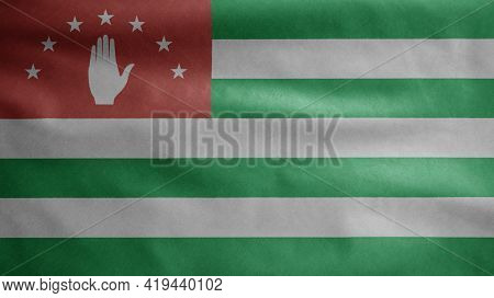 Abkhazian Flag Waving In The Wind. Close Up Of Abkhazia Banner Blowing Soft Silk