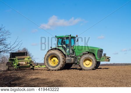 Kaliningrad Region, Russia, April 4, 2021. Spring Plowing. Agricultural Work In The Fields. A Tracto