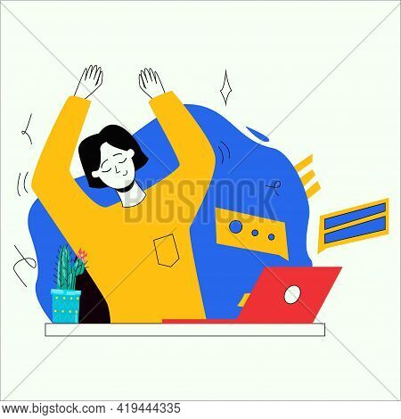 The Girl Is Sitting At The Workplace At A Laptop. The Girl Does A Warm-up At The Table At Work. The