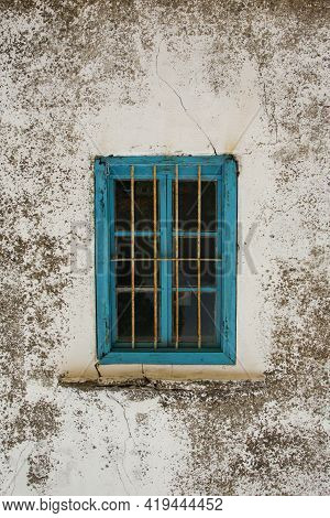 A Blue Wooden Traditional Turkish Window - Closed - Shut - White Wall As A Background With Blank Spa