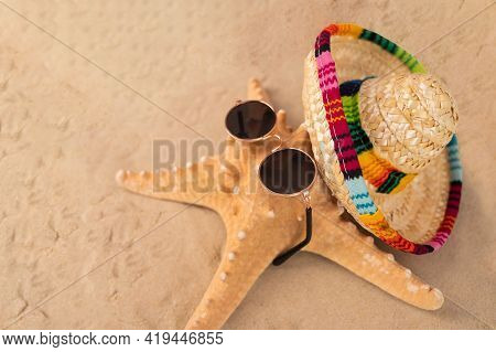 Starfish In Sunglasses And Sombrero On The Sand. Summer Vacation Concept,