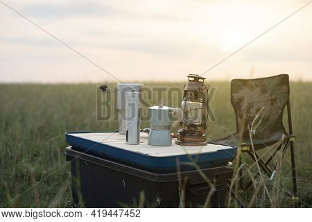 Coffee Maker Is Placed On Top Of Camping Box, Copy Space.