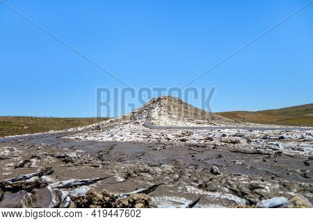 View On Mud Volcano As It Looks From Ground. There Is Mud Eruption, Its Flows Are Everywhere. Some O