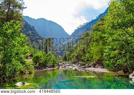 Small Lake And Stream In The Mountains On A Sunny Summer Day