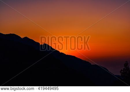 Bright Sunset In The Mountains On A Summer Evening