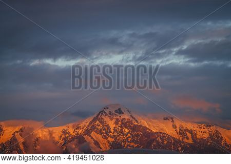 Scenic Mountain Landscape With Great Snowy Mountains Lit By Dawn Sun Among Low Clouds. Awesome Alpin