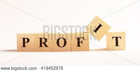 On A Light Background, Wooden Cubes With The Text Profit