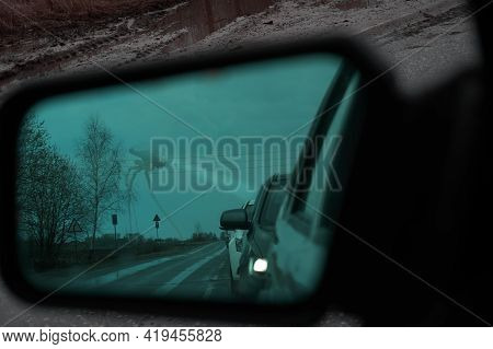 A Rear-view Mirror With An Anti-reflective Coating. Cars Stand In A Row, Queue. In The Background Yo
