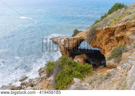 Natural Stone Arc From Rocks, Coastline And Blue Beautiful Sea At Turkey, Alanya, View At The Cliff.