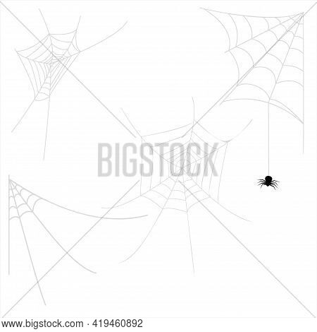 The Spider Descends From The Web. Various Cobwebs For Halloween Decoration On White Background