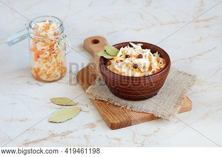 Fermented Cabbage In Bowl On A Linen Napkin On A Light Background . Homemade Sauerkraut.