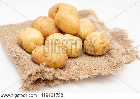 Fresh Organic Potatoes On Sackcloth Rag. Raw Potato