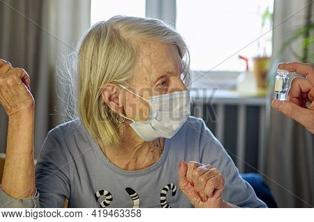 Elderly Grandmother Of 85 Years In A Mask At Home Listens To The Doctors Recommendations. Concept Of