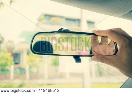 Hand Adjusting Rearview Mirror. Hand Focus In The Rearview Mirror. Adjusting The Rearview Mirror In