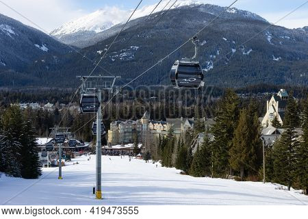 Whistler, British Columbia, Canada - March 8, 2021: View Of The Gondola Going Up The Mountain With V