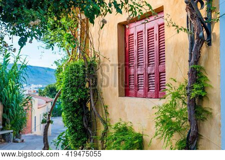 Old Mediterranean Red Window Shutters And Wall Background With Tree