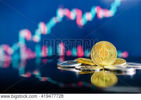 Ethereum (eth) And Other Crypto Coins With Blurred Candlestick Chart. Ethereum Is A Decentralized, O