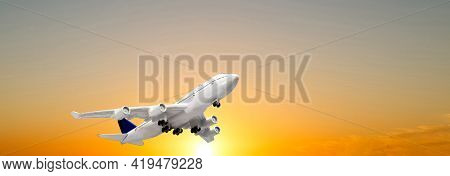 Landing Airplane. Landscape With White Passenger Airplane Is Flying In The Blue Sky With Multicolore