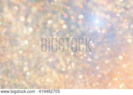Rainbow Background With Shiny Gold Sequins. Glittering Gold, Festive Light Background.