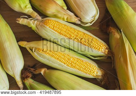 Top View Of Fresh Ear Of Corn Lay Down On The Table Ready To Prepare To Make Healthy Corn Recipe. Co
