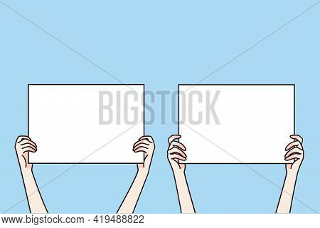 Copy Space Blank Screen Concept. Human Hands Holding Screens With Blank White Spaces For Text Or Adv