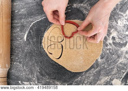 Cropped Image Of Girl Making Heart Shaped Dough. Process Of Making Shortbread Cookies.