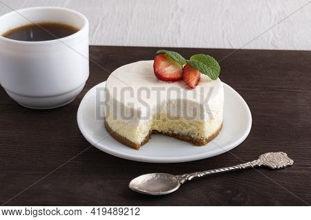 Airy Cheese Dessert, Teaspoon And Cup Of Coffee. New York Dessert Cheesecake.