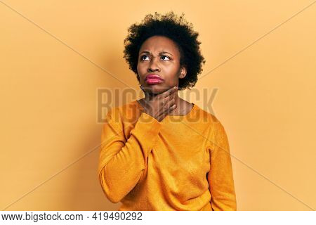 Young african american woman wearing casual clothes touching painful neck, sore throat for flu, clod and infection