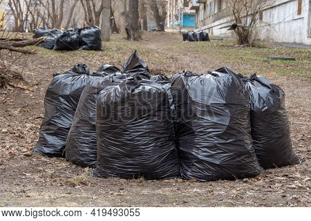 Several Black Garbage Bags On The Ground To Be Handed Over To The Garbage Collection Service. Garbag